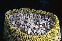 January 1998, Porto, Portugal --- Mesh Bag Full of Bottle Corks --- Image by © Owen Franken/CORBIS