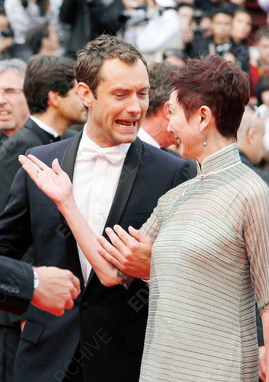 14.MAY.2011. CANNES<br /> <br /> JUDE LAW AND SANSUN SHI ON THE RED CARPET FOR THE PIRATES OF THE CARIBBEAN: ON THE STRANGER TIDES PREMIERE AT THE 64TH CANNES INTERNATIONAL FILM FESTIVAL 2011 IN CANNES, FRANCE<br /> <br /> BYLINE: EDBIMAGEARCHIVE.COM<br /> <br /> *THIS IMAGE IS STRICTLY FOR UK NEWSPAPERS AND MAGAZINES ONLY*<br /> *FOR WORLD WIDE SALES AND WEB USE PLEASE CONTACT EDBIMAGEARCHIVE - 0208 954 5968*