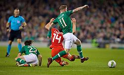 DUBLIN, IRELAND - Tuesday, October 16, 2018: Wales' Connor Roberts is fouled by Republic of Ireland's Harry Arter during the UEFA Nations League Group Stage League B Group 4 match between Republic of Ireland and Wales at the Aviva Stadium. (Pic by Paul Greenwood/Propaganda)