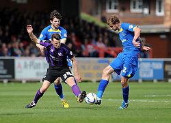 Bristol Rovers' Ollie Clarke is tackled by AFC Wimbledon's Harry Pell - Photo mandatory by-line: Dougie Allward/JMP - Mobile: 07966 386802 05/04/2014 - SPORT - FOOTBALL - Kingston upon Thames - Kingsmeadow - AFC Wimbledon v Bristol Rovers - Sky Bet League Two