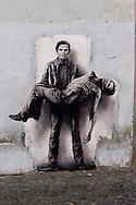 Roma 20 Maggio 2015<br /> Il murales di Pier Paolo Pasolini a piazza San Callisto a Trastevere. L'immagine raffigura lo scrittore cineasta, assassinato il 2 novembre 1975, che porta in braccio il suo corpo senza vita. Una sorta di pietà che ha attirato l'attenzione di romani e turisti in giro per Trastevere.<br /> Rome May 20, 2015<br /> The murals of Pier Paolo Pasolini in Piazza San Callisto in Trastevere. The image depicts the writer filmmaker assassinated the Nov. 2, 1975,  that brings in arm her lifeless body. A kind of piety that has attracted the attention of the Romans and tourists around Trastevere.