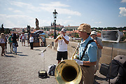 """The """"Kalbo Bridge Band"""" performing for natives, tourists and visitors on a crowded Charles Bridge."""