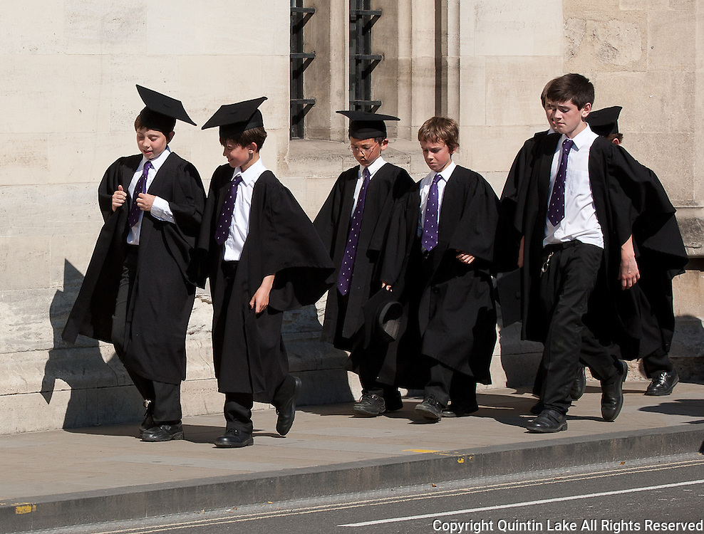 Boy choristers from Magdalen College School below Magdalen Great Tower, Oxford High Street, England