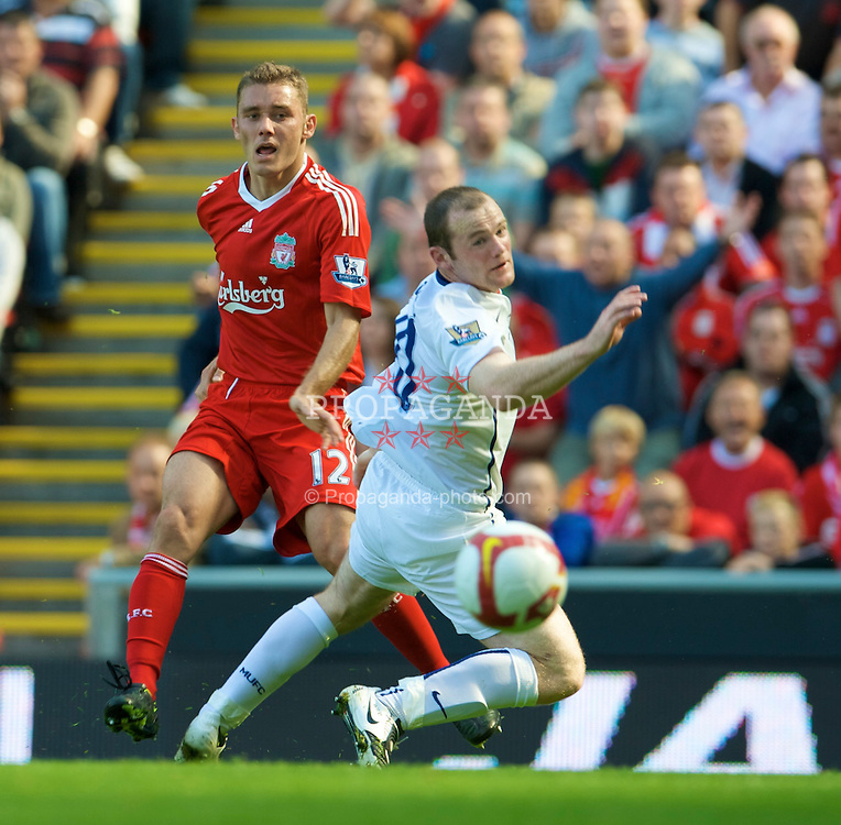 LIVERPOOL, ENGLAND - Saturday, September 13, 2008: Liverpool's Fabio Aurelio and Manchester United's Wayne Rooney during the Premiership match at Anfield. (Photo by David Rawcliffe/Propaganda)