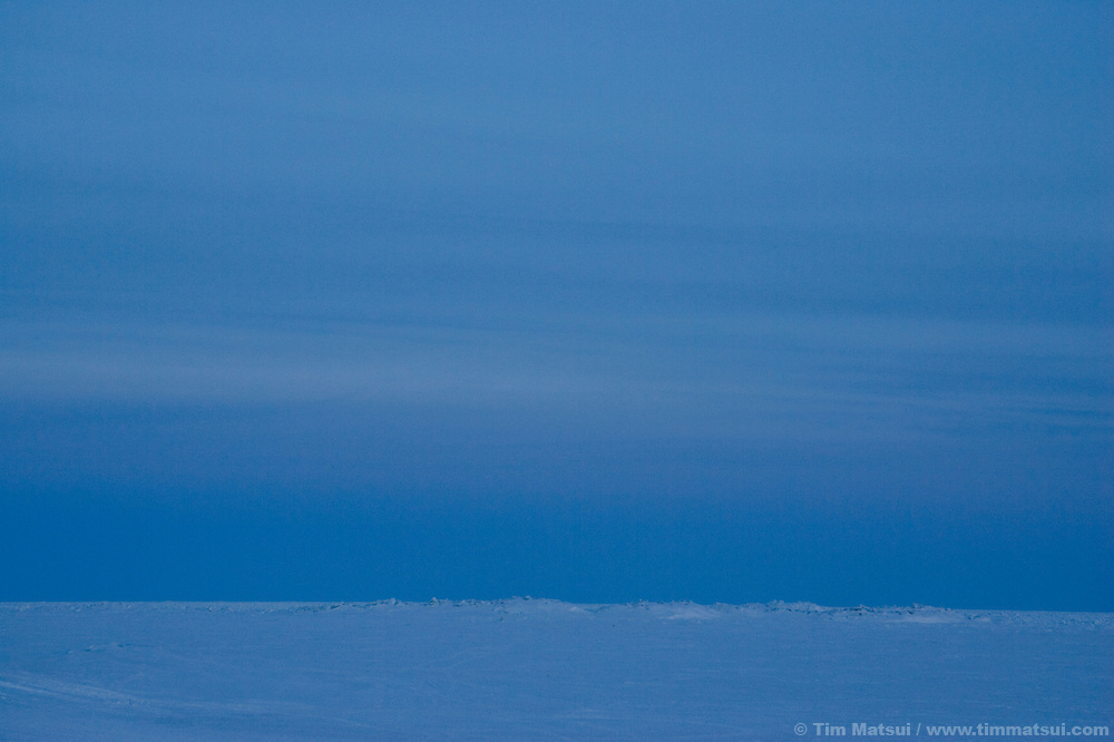 Pack ice stretches to the horizon outside the rural Inupiat Eskimo village of Kivalina, Alaska.