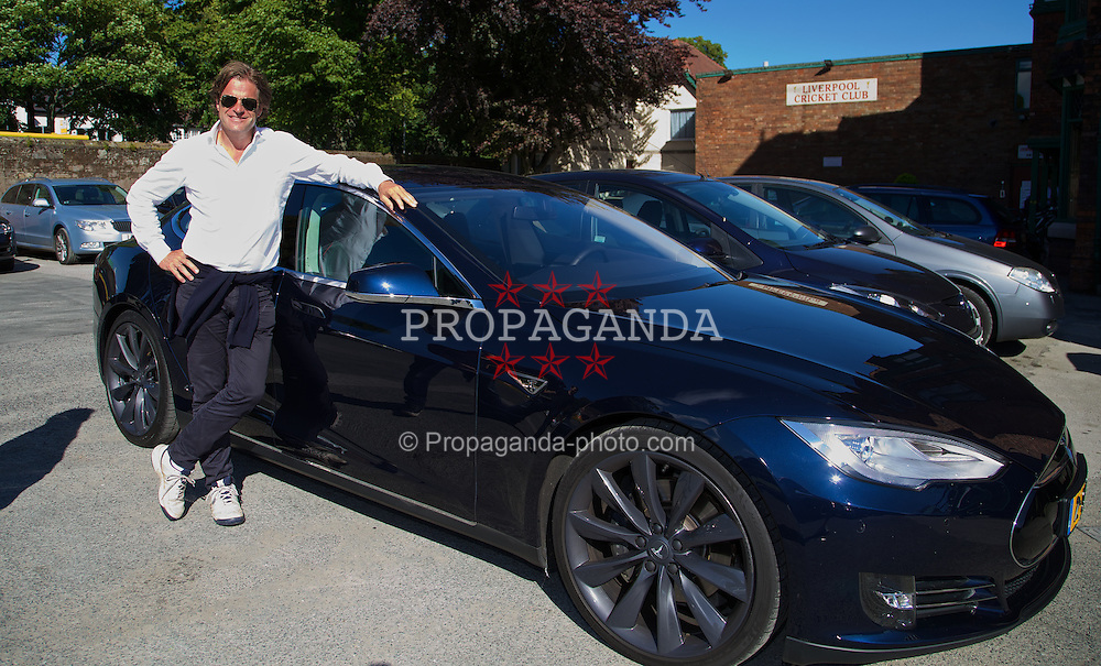 LIVERPOOL, ENGLAND - Saturday, June 21, 2014: Tournament Director Anders Borg with a Tesla Model S during Day Three of the Liverpool Hope University International Tennis Tournament at Liverpool Cricket Club. (Pic by David Rawcliffe/Propaganda)