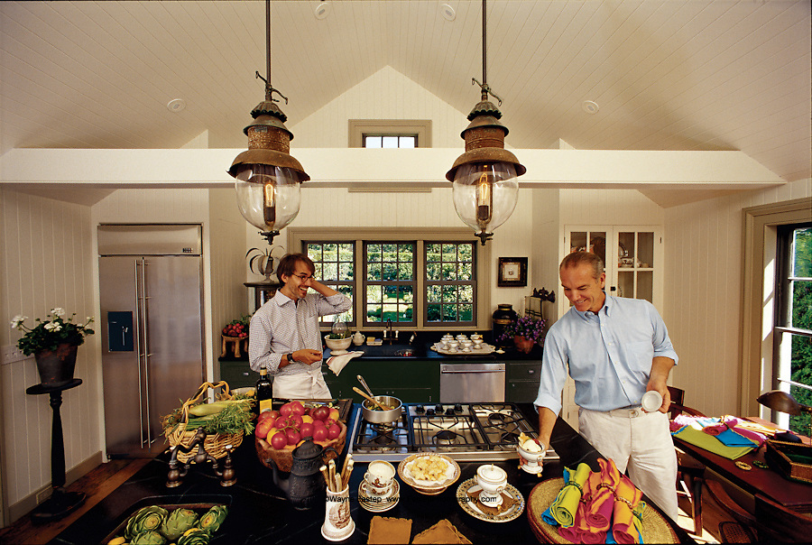 Designers John Dransfield (r) and Geoffrey Ross designers of decor and decoratiors of surroundings in their kitchen, East Hampton.