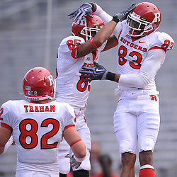 Apr 24, 2010; Piscataway, NJ, USA; White wide receiver Keith Stroud (83) celebrates his touchdown with wide receiver Eddie Poole (85) and tight end Tony Trahan (82) during Rutgers Scarlet and White intersquad NCAA football scrimmage at Rutgers Stadium. The Scarlet squad defeated the White, 16-7.