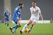 AFC Wimbledon defender George Francomb (7) and Milton Keynes Dons midfielder Darren Potter (8) during the EFL Sky Bet League 1 match between Milton Keynes Dons and AFC Wimbledon at Stadium MK, Milton Keynes, England on 10 December 2016. Photo by Stuart Butcher.