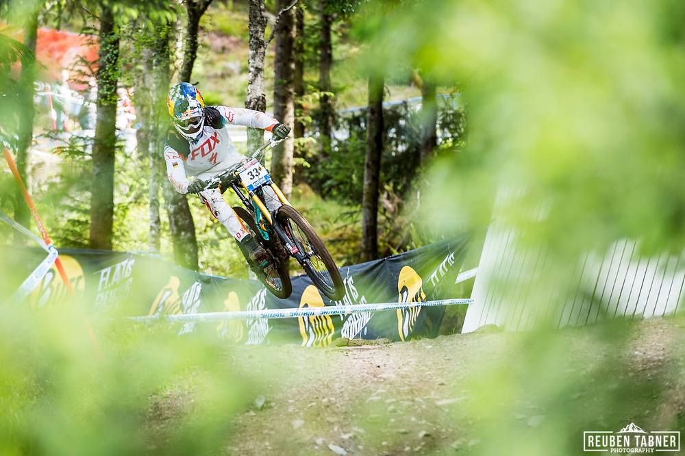 Loic Bruni of Specialized Gravity grabs some air during his race run at the UCI Mountain Bike World Cup in Fort William.