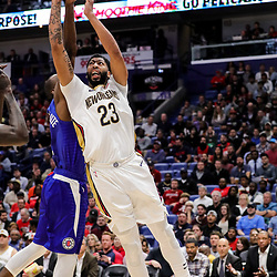 Oct 23, 2018; New Orleans, LA, USA; New Orleans Pelicans forward Anthony Davis (23) shoots over Los Angeles Clippers forward Luc Mbah a Moute (12) during the second half at the Smoothie King Center. The Pelicans defeated the Clippers 116-109. Mandatory Credit: Derick E. Hingle-USA TODAY Sports
