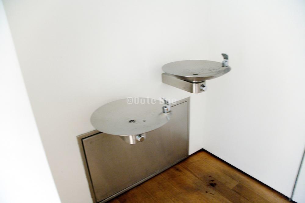 drinking water fountain near public toilet blurry