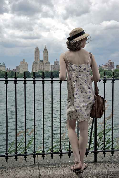 A girl enjoys a view on upper west side from Central Park.