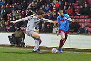 Colchester United player Tom Eastman(18) and Scunthorpe United player Kevin van Veen (10) during the EFL Sky Bet League 2 match between Scunthorpe United and Colchester United at Glanford Park, Scunthorpe, England on 14 December 2019.