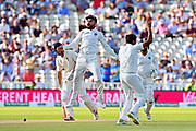 Wicket - Ravichandran Ashwin of India celebrates taking the wicket of Alastair Cook of England with Virat Kohli (captain) of India leaping in the air during second day of the Specsavers International Test Match 2018 match between England and India at Edgbaston, Birmingham, United Kingdom on 2 August 2018. Picture by Graham Hunt.