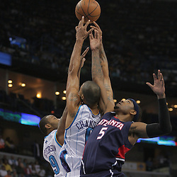 05 November 2008:  New Orleans Hornets players Tyson Chandler (6) and Morris Peterson (9) fight for a rebound with Atlanta Hawks forward Josh Smith (5) during the first half of a NBA game between the New Orleans Hornets and the Atlanta Hawks at the New Orleans Arena in New Orleans, LA..