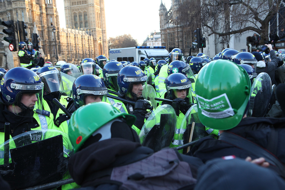 "For weeks now, Britain's students have been protesting a proposal from the new Conservative-led government that aims to triple tuition fees for university students. On 9 December, as the proposal went to vote in the parliament, tens of thousands of students marched a few miles from the University of London Union to just a couple hundred meters from parliament where they ""kettled"" (encircled) by police. While protestors argued with officers and burned bonfires to stay warm in the near freezing temperatures, parliamentarians passed the plan to raise tuitions by a majority of 21 votes."