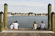 """Annapolis, Maryland - June 05, 2016: People hang out at the pier off Dock Street in Historic Annapolis, Md., Sunday June 5th, 2016. Annapolis is one of the most prone cities in the U.S. to nuisance flooding. <br /> <br /> <br /> A perigean spring tide brings nuisance flooding to Annapolis, Md. These phenomena -- colloquially know as a """"King Tides"""" -- happen three to four times a year and create the highest tides for coastal areas, except when storms aren't a factor. Annapolis is extremely susceptible to nuisance flooding anyway, but the amount of nuisance flooding has skyrocketed in the last ten years. Scientists point to climate change for this uptick. <br /> <br /> <br /> CREDIT: Matt Roth for The New York Times<br /> Assignment ID: 30191272A"""