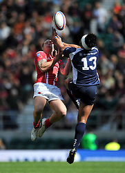 LBdr Owain Davies of the Army competes with Logs (SC) Sili Buinimasi of the Royal Navy for the ball in the air - Photo mandatory by-line: Patrick Khachfe/JMP - Mobile: 07966 386802 09/05/2015 - SPORT - RUGBY UNION - London - Twickenham Stadium - Army v Royal Navy - Babcock Trophy