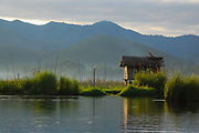 A small dwelling on Inle Lake in Burma (Myanmar) on a misty morning