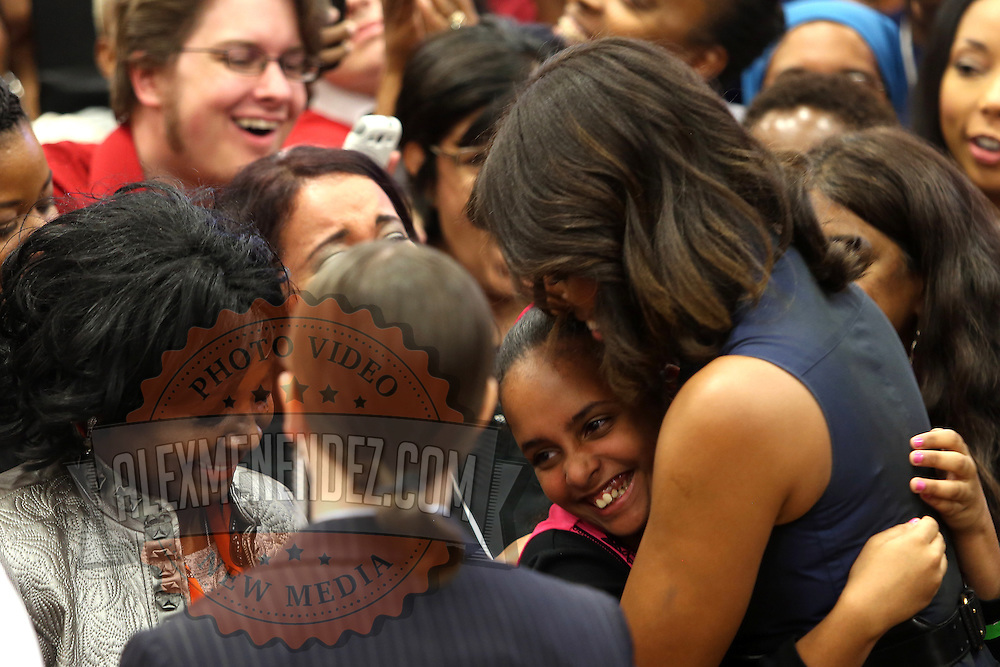"""First Lady Michelle Obama poses with Charlie Crist  supporters after she appeared at his grassroots """"Commit to Vote"""" rally. The campaign called on the event to """" energize voters and lay out the stakes for Floridians in the critical election on November 4th."""" at the Barnett Park Gymnasium in Orlando, Florida on Friday, Nov. 17, 2014. (AP Photo/Alex Menendez)"""