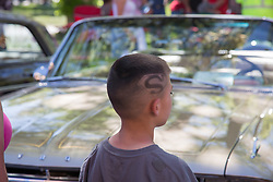 boy with Superman symbol carved in his hair