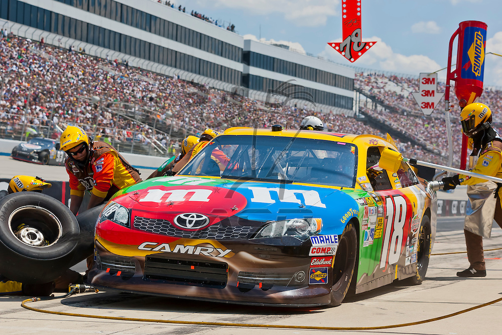 DOVER, DE - JUN 03, 2012:  Kyle Busch (18) brings in his MMs Toyota for service during the FedEx 400 Benefiting Autism Speaks at the Dover International Speedway in Dover, DE.
