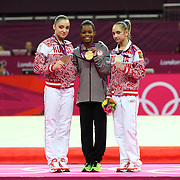 Gabrielle Douglas, USA, winning the Gold Medal in the Women's Individual All Round competition with silver medalist Victoria Komova, Russia, (right) and bronze medal winner Aliya Mustafina, (left) during the artistic gymnastic competition at North Greenwich Arena during the London 2012 Olympic games London, UK. 2nd August 2012. Photo Tim Clayton