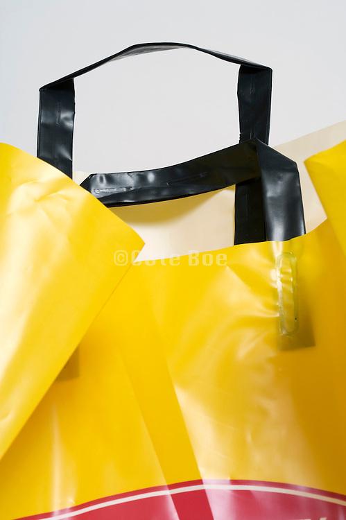 handles of sturdy plastic shopping bag