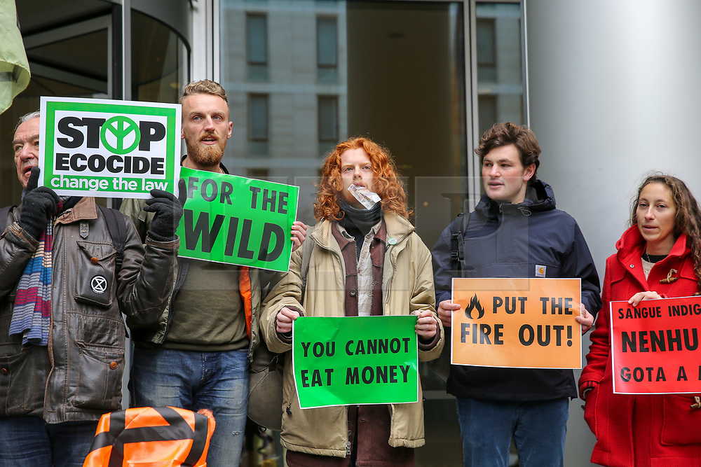 © Licensed to London News Pictures. 15/11/2019. London, UK. Activists from Extinction Rebellion climate change group protest outside the offices of asset manager BlackRock in City of London. BlackRock is the world's top investor in deforestation and coal, the top US investor in oil & gas, and one of the world's largest asset managers, controlling more funds than the GDP of Japan.Photo credit: Dinendra Haria/LNP