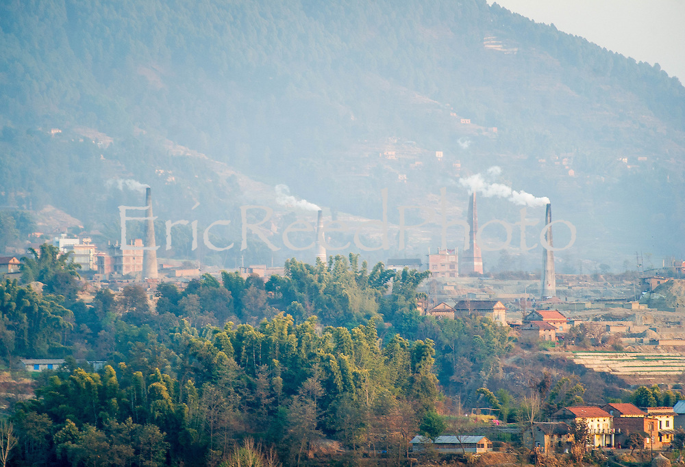 Jan 20, 2013 - Smokestacks spew smoke into the air of Kathmandu Valley, Nepal, as industry emission standards are largely unsupervised as air quality severely deteriorates causing environmental and public health concerns.<br /> <br /> Story Summary: It is said that the battle over global warming is to be won or lost in Asia. With growing populations and new economic boom in the global markets across Asia countries like India, Nepal and Cambodia have to grapple with the success and the environmental disaster that comes with ramped up production in unchecked or unregulated industries to compete in todays marketplace. The catastrophic air pollution makes for new problems to be dealt with such as a future health crisis, quality of life issues and the tarnished image of reduced visibility to world heritage sites for tourism.