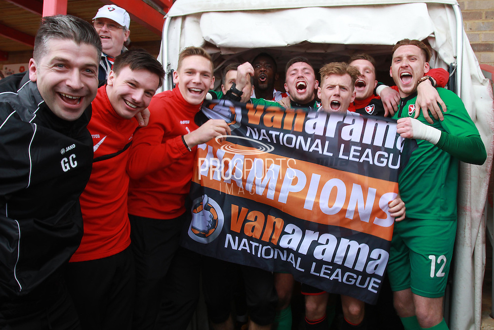 Cheltenham players celebrate winning the National League after the Vanarama National League match between Cheltenham Town and FC Halifax Town at Whaddon Road, Cheltenham, England on 16 April 2016. Photo by Antony Thompson.