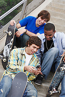 Young Skateboarders with Cell Phone