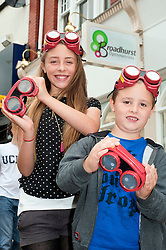 Lauren and Adam Powel with the special goggles which simulate visual impairments, to demonstrate the importance of eye checks for children out side the new Broadhursts Optometrists which opened in Preston on Saturday  ..18 August 2012.Image © Paul David Drabble