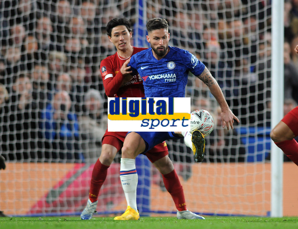 Football - 2019 / 2020 Emirates FA Cup - Fifth Round: Chelsea vs. Liverpool<br /> <br /> Takumi Minamino of Liverpool and Olivier Giroud of Chelsea, at Stamford Bridge.<br /> <br /> COLORSPORT/ANDREW COWIE