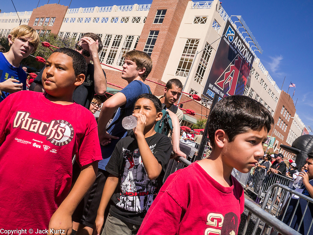 16 SEPTEMBER 2012 - PHOENIX, AZ:  Boys wait for Lucha Libre wrestlers to arrive at Chase Field for a wrestling match Sunday. The Arizona Diamondbacks hosted their 14th Annual Hispanic Heritage Day, Sunday to kick off Hispanic Heritage Month (Sept. 15-Oct. 15) before the 1:10 p.m. game between the D-backs and San Francisco Giants. The main attraction of the Day was three Lucha Libre USA exhibition wrestling matches in front of Chase Field stadium before the game.    PHOTO BY JACK KURTZ