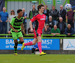Forest Green Rovers's Kurtis Guthrie and Dover Athletic's Sean Raggett chase after the ball - Photo mandatory by-line: Nizaam Jones - Mobile: 07966 386802 - 25/04/2015 - SPORT - Football - Nailsworth - The New Lawn - Forest Green Rovers v Dover - Vanarama Conference League