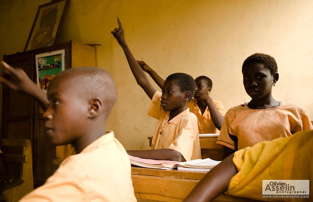 "Soale Ibrahim, 16, (center) attends class at the Nyologu Primary School in the village of Nyologu, northern Ghana, on Wednesday June 6, 2007. ""At school, we get egg, meat fish, that we usually don't eat at home,"" says Soale..."