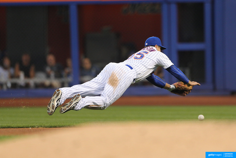 Kelly Johnson, New York Mets, fielding at second base during the New York Mets Vs Los Angeles Dodgers MLB regular season baseball game at Citi Field, Queens, New York. USA. 25th July 2015. Photo Tim Clayton