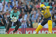 Hampshire T20 all-rounder Darren Sammy is caught by Surrey Wicket-Keeper Ben Foakes off of the bowling Surrey All-Rounder Zafar Ansari during the NatWest T20 Blast South Group match between Surrey County Cricket Club and Hampshire County Cricket Club at the Kia Oval, Kennington, United Kingdom on 9 June 2016. Photo by David Vokes.