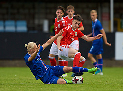 RHYL, WALES - Monday, September 4, 2017: Wales' Dylan Levitt is tackled by Iceland's Kolbeinn Birgir Finnsson during an Under-19 international friendly match between Wales and Iceland at Belle Vue. (Pic by Paul Greenwood/Propaganda)
