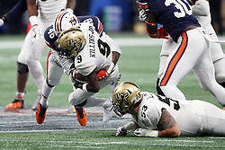 UCF Knights running back Adrian Killins Jr. (9) is tackled by Auburn Tigers linebacker Montavious Atkinson (48) during the 2018 Chick-fil-A Peach Bowl NCAA football game on Monday, January 1, 2018 in Atlanta. (Jason Parkhurst / Abell Images for the Chick-fil-A Peach Bowl)