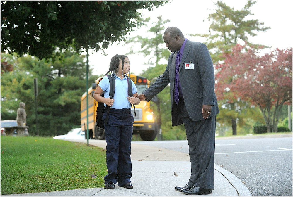 Principal Leverne Marshall greets third-grader Shakyla Williams outside of William Marvin Bass Elementary School.  Teachers at Bass said Marshall's passion for students inspires them, too.