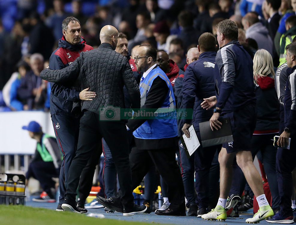 Swansea City manager Paul Clement (left) and Reading manager Jaap Stam after the final whistle of the Carabao Cup, third round match at the Madejski Stadium, Reading.
