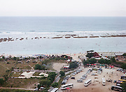 The Pandawa Beach area, a new tourist destination in the southern coast of Bali, seen from above one of the adjacent hills. Most parts of the beach were seaweed cultivation areas, now transforming into a new tourist destination. Some developers have begun constructing resorts and hotels along the seaside. According to a record, around 3,5 million tourists from around the world visited the island for vacation in 2014. Most of them preferred staying in the southern coast such as in Kuta, Nusa Dua, and Sanur. These are the tourism hubs of Bali that naturally attract investors' interest to build hotels and other leisure establishments. The island's tourism is indeed inseparable from its southern coast's history, an area blessed with breathtaking beaches. It is from here the Bali holiday business began to develop as the influx of Australian hippies and surfers to Kuta started back in the 70s. The fishermen's villages would later transform drastically because of it. Hotels, restaurants, and other facilities were growing and spreading along the coast so fast like mushrooms in a rainy season.