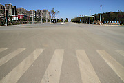 CHENGGONG, CHINA -China Out - Finland Out<br /> <br /> Ghost City <br /> <br /> Photo shows a street on November 22, 2013 in Chenggong, Yunnan Province of China. Chenggong is a satellite city located just south of Kunming. As of 2012, much of the newly constructed housing in Chenggong is still unoccupied, and it is reportedly one of the largest ghost towns in Asia. According to a China Youth Daily report in July, at least 12 such ghost cities across the country have been found. Besides the best known of these - Ordos in North China's Inner Mongolia Autonomous Region, the list also included Changzhou in Jiangsu, Zhengdong New Area in Henan Province, Shiyan in Hubei and Chenggong District of Kunming in Yunnan.<br /> ©Exclusivepix