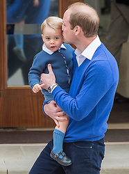 The Duke of Cambridge with his son Prince George as he arrives at the Lindo Wing of St Mary's Hospital in London, after the birth of his newborn daughter.