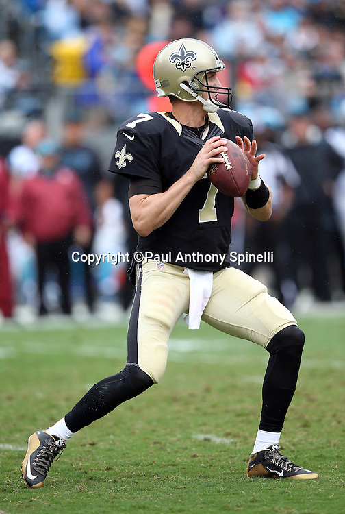 New Orleans Saints quarterback Luke McCown (7) throws a deep pass in the third quarter during the 2015 NFL week 3 regular season football game against the Carolina Panthers on Sunday, Sept. 27, 2015 in Charlotte, N.C. The Panthers won the game 27-22. (©Paul Anthony Spinelli)