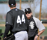 GLENDALE, AZ - FEBRUARY 23:  Pitching coach Don Cooper #21 observes pitcher Jake Peavy #44 of the Chicago White Sox during a workout on February 23, 2010 at the White Sox training facility at Camelback Ranch in Glendale, Arizona. (Photo by Ron Vesely)