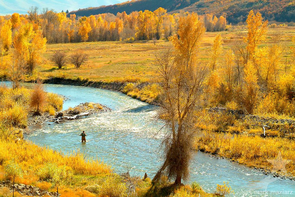 Fly fishing the Provo River below Jordanelle Dam, outside of Heber City, Utah.